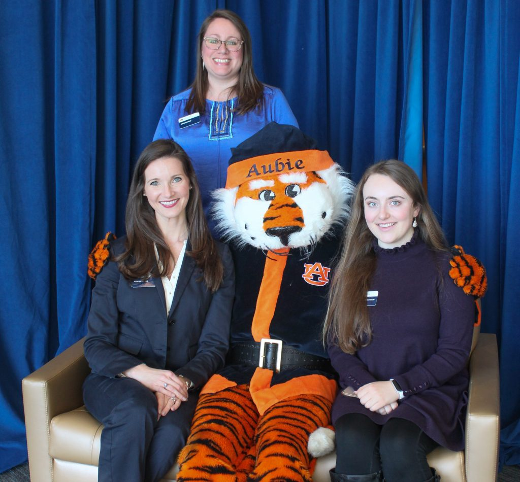 Assessment team with Aubie Claus